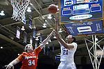 10 February 2017: Duke's Kendall Cooper (21) shoots over Syracuse's Abby Grant (34). The Duke University Blue Devils hosted the Syracuse University Orange at Cameron Indoor Stadium in Durham, North Carolina in a 2016-17 Division I Women's Basketball game. Duke won the game 72-55.
