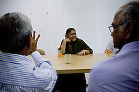 Dr. Vandana Shiva sits down for a welcome drink as she chats with the University Dean (left) and other officials and upper management in Solan, Himachal Pradesh, India, on 7th September 2009...Dr. Vandana Shiva, the founder of Navdanya Foundation and Bijavidyapeeth, is a physicist turned environmentalist who campaigns against genetically modified food and teaches farmers to rely on indigenous farming methods.. .Photo by Suzanne Lee / For The National