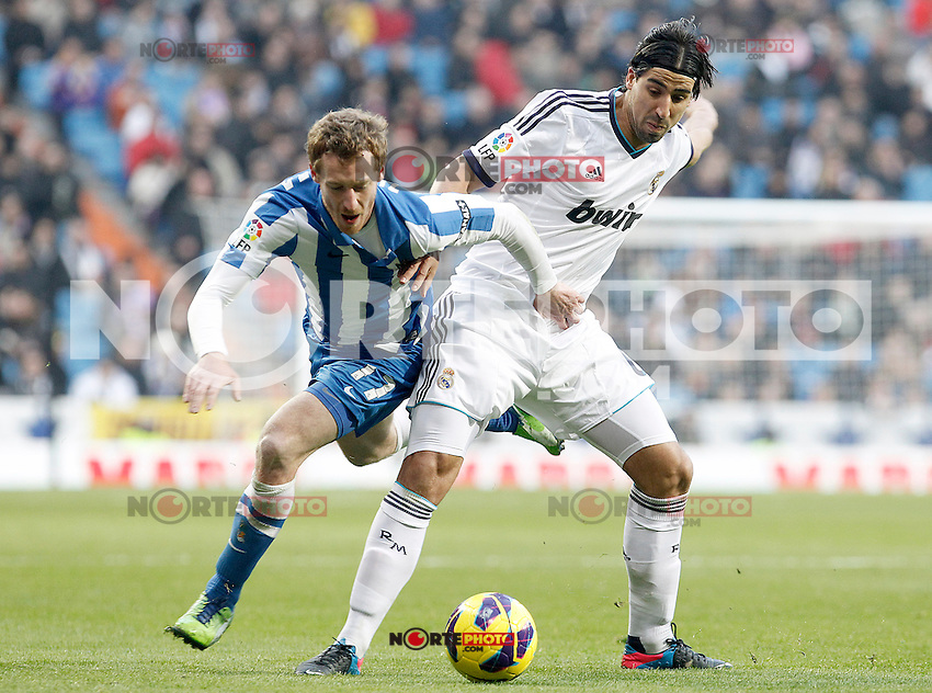 Real Madrid's Sami Khedira (r) and Real Sociedad's David Zurutuza during La Liga match.January 06,2013. (ALTERPHOTOS/Acero)