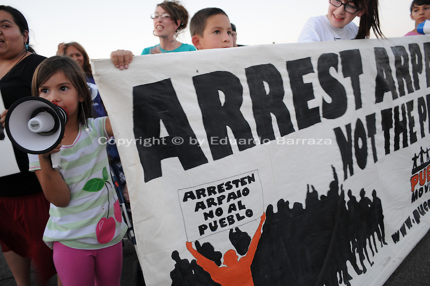 """Phoenix, Arizona. June 23, 2012 - Members of the Unitarian Universalist church and community advocates gathered outside the Tent City Jail in Arizona to demand  Sheriff Joe Arpaio to shut down what they call a """"concentration camp"""" and inhumane outdoor jail facility. Tent City houses inmates in canvas tents and during the summer the temperature raises significantly under the tents. In this image,  a four-year old girl uses a bullhorn to demonstrate against Sheriff Joe Arpaio during the protest to demand the closure of the Tent City Jail. Photo by Eduardo Barraza © 2012"""
