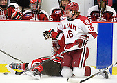 Jordan Dewey (St. Lawrence - 44), Alex Fallstrom (Harvard - 16) - The Harvard University Crimson defeated the St. Lawrence University Saints 4-3 on senior night Saturday, February 26, 2011, at Bright Hockey Center in Cambridge, Massachusetts.