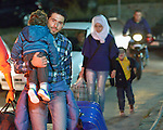 A Syrian refugee family walks through the streets of the Greek island of Chios in order to take a ferry to Athens. They came to the island by crossing the Aegean Sea in a small boat from Turkey. They were then registered and provided with food and shelter in a reception center built with support from International Orthodox Christian Charities, a member of the ACT Alliance. They then plan to take a ferry to Athens and then on toward western Europe. Hundreds of thousands of refugees and migrants have passed through Greece in 2015.