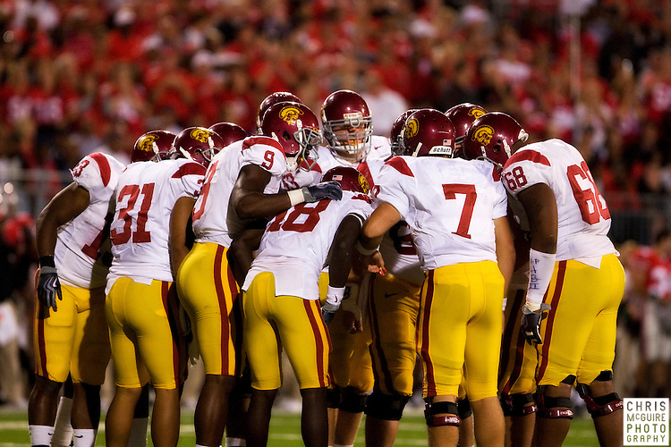 12 September 2009:  Football -- The USC offense huddles during their game against Ohio State at Ohio Stadium in Columbus.  USC won 18-15.  Photo by Christopher McGuire.