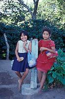 two barefoot Nicaraguan girls selling ceramics in San Juan de Oriente, Pueblos Bloncos, Nicaragua