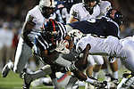 Ole Miss running back Jeff Scott (3) picks up a first down vs. Vanderbilt defensive back Trey Wilson (8) at Vaught-Hemingway Stadium in Oxford, Miss. on Saturday, November 10, 2012. (AP Photo/Oxford Eagle, Bruce Newman)