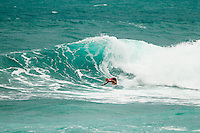 HONOLULU - (Monday, December 3, 2012) Kelly Slater (USA) . -- North Shore's John John Florence, the defending champion of the VANS World Cup of Surfing and the VANS Triple Crown series title, posted the highest heat score of the event at Sunset Beach today - 17.8 points out of 20. This is the third of four days of competition and Florence heads into tomorrow's World Cup final rounds as the man to beat.    Florence, 20, hit the waves immediately after 11X world champion Kelly Slater returned to the beach with a heat win, thinking he was the top scorer of the event: 17.04 points. As Slater sat in the VANS LIVE interview chair, he watched the tables turn right in front of his eyes...Florence had reason to be motivated in the 10-foot surf (wave face heights), finding himself out with fellow Sunset surfer Billy Kemper, younger brother Nathan Florence, and VANS Triple Crown contender Fred Patacchia. ..Kemper opened with a perfect 10 wave score after a couple of high risk lip gouges, and John John knew he had no time for warming up in the shifty, lumpy conditions. He answered back with a succession of deep, carving rides. He eventually took the win with Kemper second, Patacchia third, and Nathan Florence fourth. Patacchia's loss likely takes him out of contention for the VANS Triple Crown series title after his top-4 finish at Haleiwa..The second jewel of the $1M VANS Triple Crown of Surfing, the VANS World Cup will require four full days of competition between now and December 6...Winner of the first jewel - the REEF Hawaiian Pro - last week was Sebastian Zietz (HAW). Zietz is seeded through to the round of 64 and will surf on Day 3 of the competition..  Photo: joliphotos.com