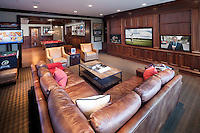 This home's basement gaming area keeps everyone busy for hours yet continuously connected via the home control system