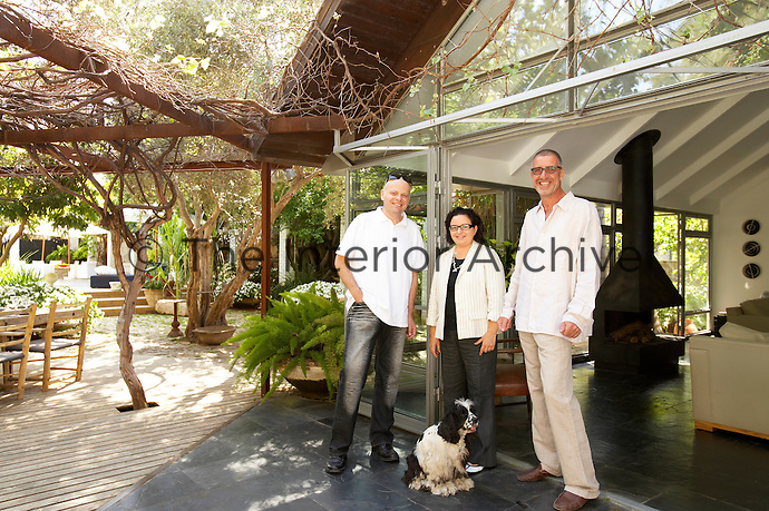 Joshua (right) and Anat Kastiel with architect Alex Meitlis outside their house in Tel Aviv.