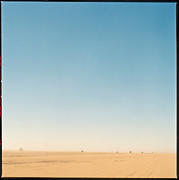 Sahara desert, Libya-Chad, November/December 2004..Every week, a convoy of 40 privately owned Libyan trucks loaded by the WFP with about 1000 metric tons of western food aid cross 2500 km of deep desert across Libya and Chad to reach more than 200 000 refugees from Darfur in camps near the Sudanese border. The convoy crawls under the blazing Sahara sun...