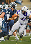 8 October 2016: Amherst College Purple & White Defensive Lineman Paul Johnson, a Senior from Moorestown, NJ, pressures Middlebury College Panther Quarterback Jared Lebowitz, a Junior from Burlington, VT, at Alumni Stadium in Middlebury, Vermont. The Panthers edged out the Purple & While 27-26. Mandatory Credit: Ed Wolfstein Photo *** RAW (NEF) Image File Available ***