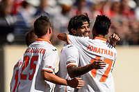 Valencia C. F. midfielder Ever Banega (10) celebrates scoring with forward Paco Alcacer (25) and forward Jonathan Viera (17) during round two of the 2013 Guinness International Champions Cup at MetLife Stadium in East Rutherford, NJ, on August 04, 2013.