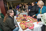 Rhonda Hughes (right) talks with baker Jen MIller from Crumbs bakery about their free samples at the annual Wellworks Winter Gathering. Photo by Ben Siegel