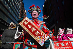 New York, United States. 17th February 2013 -- A chinese resident takes part of the lunar new year of the snake during celebrations of the Chinese new year in New York. Photo by Eduardo Munoz Alvarez / VIEWpress.