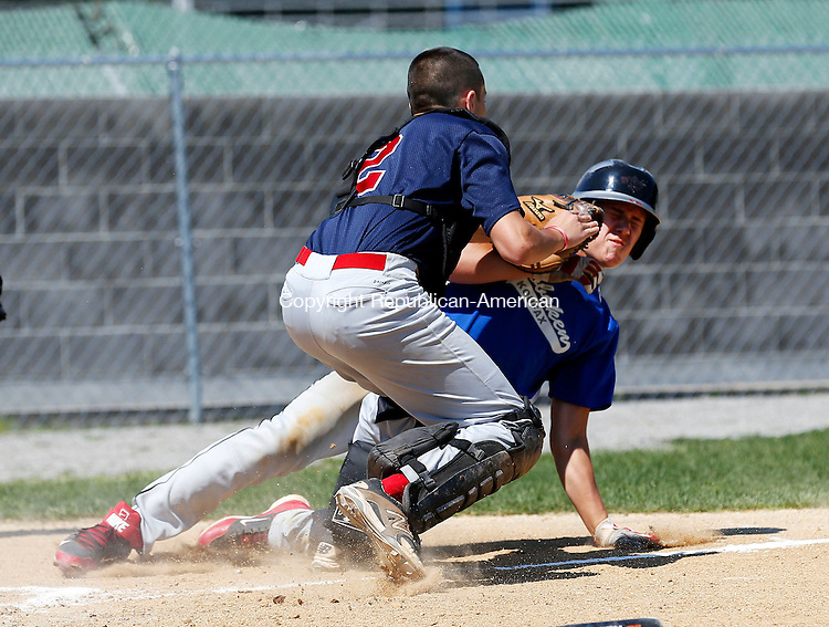 Waterbury, CT- 16 July 2015-071615CM04- Wolcott  catcher Ricky Burdick, left, tags out Hoboken's (New Jersey) Josh O'Neil after he attempted to pick up an extra base and score during their Sandy Koufax North Atlantic Regional baseball game at Municipal Stadium in Waterbury on Thursday.    Christopher Massa Republican-American
