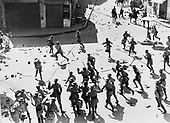 British soldiers chasing Arab rioters in Jaffa, 1933. Photographer Zoltan Kluger.