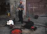 A butcher stands over his freshly-slaughtered goats on a village street in southern Lebanon in 1981.