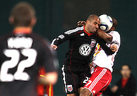 Fred (27) of D.C. United heads the ball away from Roy Miller (7) of the New York Red Bulls during an MLS match at RFK Stadium, in Washington D.C. on April 21 2011. Red Bulls won 4-0.