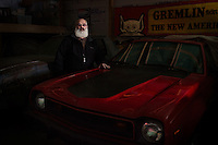 Reinholds, Pennsylvania, February 10, 2015 - A portrait of Brian Moyer in one of his garages, here in front of a one-of-a-kind 1974 Gremlin XP, a second generation 2 prototype never released, and which was originally owned by Richard Teague, the design chief at AMC and one of the cars inventors. <br /> <br /> Moyer owns 16 AMC Gremlins. The Gremlin was introduced on April Fools Day (April 1) in 1970 featuring a shortened Hornet body with a Kammback tail and was manufactured in the US via AMC and in Mexico via AMC's subsidiary VAM. It's lifecycle ended in 1978 when it was replaced by the AMC Spirit. Moyer became interested as a kid when he saw the early Gremlin commercials in 1970. His first car was a Gremlin and he has never not owned one. Today he has arguably the most unique collection of Gremlins in the world, including several that are one-of-a kind models. <br /> <br /> CREDIT: Daryl Peveto for The Wall Street Journal<br /> Photo Assignment ID: 36892 <br /> Slug: MYRIDE_Gremlin