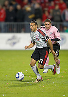 28 April 2010: Toronto FC forward Dwayne De Rosario #14 takes the ball up field as Montreal Impact midfielder Phillippe Billy #21 gives chase during a Nutrilite Canadian Championship game between the Montreal Impact and Toronto FC at BMO Field in Toronto..Toronto FC won 2-0.....