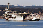 The USS Ranger is towed from Puget Sound Naval Shipyard's Inactive Ship Maintenance Facility in Bremerton, WA. on March 5, 2015. The carrier is en route to scraped at International Shipbreaking in Texas.The aircraft carrier was active from 1957 to 1993, when it entered the mothball fleet. The Navy announced a deal Dec. 22 to pay a penny and the value of the ship's scrap metal to take it away. It must make a five-month, 16,000-mile trip around South America because it can't fit through the Panama Canal.  ©2015. Jim Bryant Photo. All RIGHTS RESERVED.