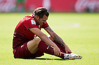 Hugo Almeida of Portugal hold his ankle in pain