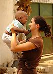 Gabrielle Fondiller gives love to a baby in a Likoni orphanage supported by her foundation, Hatua Likoni.  Hatua supports needed primary and secondary school students, and an orphanage.