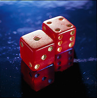 Red dice on blue background