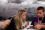 Teaching Assistant Haley Carpenter, left, helps her student Eric Simioni, 14, with soldering a solar-powered car during Principles of Engineering Design class during Center for Talented Youth summer program at Lafayette College in Easton, PA on July 06, 2012. Several students were part of the Rural Connections scholarship program being offered for the first time this year.