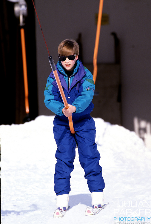 Prince William sking in Lech, Austria, during an annual ski holiday with his mother, The Princess of Wales, and his brother, Prince Harry