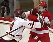 Zach Walker (BC - 14), Charlie McAvoy (BU - 7) - The visiting Boston University Terriers defeated the Boston College Eagles 3-0 on Monday, January 16, 2017, at Kelley Rink in Conte Forum in Chestnut Hill, Massachusetts.
