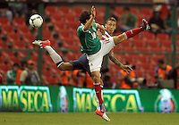 MEXICO CITY, MEXICO - AUGUST 15, 2012:  Fabian Johnson (23) of the USA MNT clashes with Andres Guardado (18) of  Mexico during an international friendly match at Azteca Stadium, in Mexico City, Mexico on August 15. USA won 1-0.