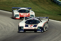 ELKHART LAKE, WI - AUGUST 24: The Team Zakspeed USA Ford Mustang Probe of Klaus Ludwig of Germany and Tom Gloy of the United States leads theTeam Zakspeed USA Ford Mustang Probe of Bobby Rahal and Pete Halsmer of the United States during the Löwenbräu Classic IMSA GT race at the Road America track  near Elkhart Lake, Wisconsin, on August 24, 1986.