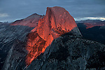 Half Dome with the final colors of sunset..The autumn season in Yosemite National Park. Leaves and grasses all around the park are changing to their fall colors, and rain and snow are beginning to fall.