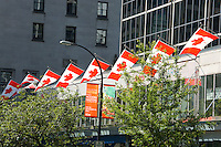 Canadian flags on Burrard Street in downtown Vancouver, British Columbia, Canada