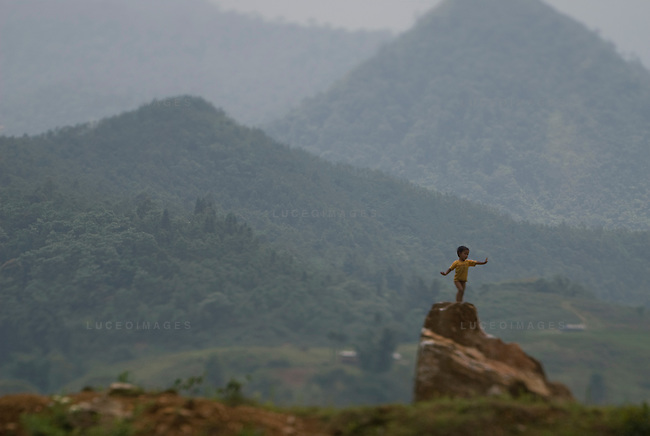 A Vietnamese boy plays in the minority villages outside of Sapa, Vietnam.