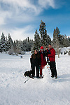 California, Lake Tahoe: Young family with child and dog enjoy snow play with sled at North Lake Tahoe Regional Park.  Photo copyright Lee Foster.  Photo # cataho107577