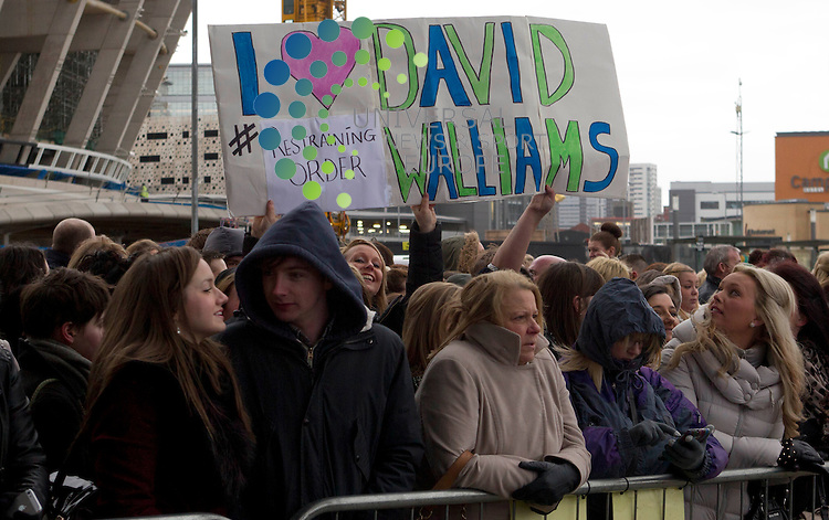 Britains Got fans with a sign for David Williams as he arrives at the SECC in Glasgow to start the Scottish leg of the show..Universal News And Sport (Scotland). 28 January 2013 www.unpixs.com.
