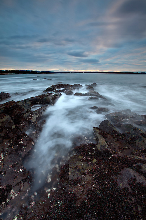 Volcanic rocks and waves from the Atlantic Ocean along Seawall in Acadia National Park, Maine, USA