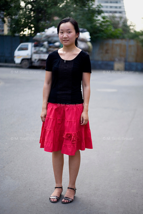 Chenqiuyu, a student, age 25, poses for a portrait in Beijing. Response to 'What does China mean to you?': 'Mother country.'  Response to 'What is China's role in the future?': 'A powerfully strong and prosperous nation.'