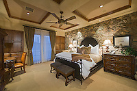 Luxurious guest bedroom with stone walls and elegant furniture