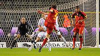 Belgium's Nicolas Lombaerts (C) scores 1:0 against US goalkeeper Tim Howard during the friendly match Belgium vs USA at King Baudoin stadium in Brussels, Belgium on September 06th, 2011.