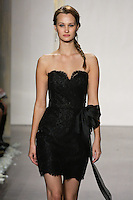 Model walks runway in a black lace pencil skirt dress, strapless sweetheart neckline, sash at natural waist bridesmaid dress by Lazaro Perez, from the Noir by Lazaro Spring 2012 Bridal fashion show.