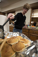 NWA Democrat-Gazette/J.T. WAMPLER Riley Young of Springdale stacks up pancakes Sunday Feb. 14, 2016 at the First Presbyterian Church in Springdale. The church youth hosted the pancake breakfast to support the Springdale High School snack pack program.