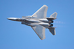 "A United States Air Force F-15 Strike Eagle piloted by Major Jason ""Bondo""  Costello from the F-15 East Coast Demonstration Team demonstrates the flight performance charectaristics of the aircraft during the 2006 Reno Air Races.  In December of 2006 the F-15 East Coast Demonstration Team began its transition to the F-22 Raptor. Photographed 09/06"