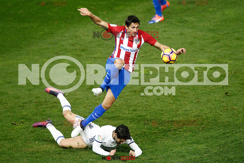 Atletico de Madrid's Stefan Savic (t) and Real Madrid's Isco Alarcon during La Liga match. November 19,2016. (ALTERPHOTOS/Acero) /NORTEPHOTO.COM