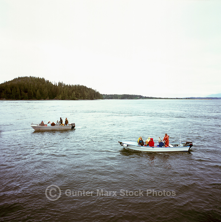 Tofino, Vancouver Island, BC, British Columbia, Canada - Tourists sightseeing in Boats around Tofino Harbour