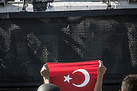 n this Tusday, Jun. 11, 2013 photo, anti-riot polcemen watch to one protester holding a Turkish flag as he stands in front of a water canyon truck during clashes at the streets of Taksim Square in Istanbul,Turkey. (Photo/Narciso Contreras).