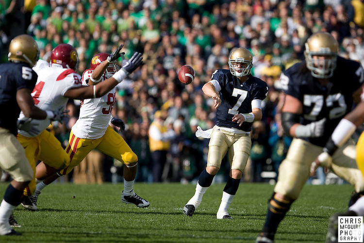 10/17/09 - South Bend, IN:  Notre Dame quarterback Jimmy Clausen gets rid of the ball against the USC defense at Notre Dame Stadium on Saturday.  USC won the game 34-27 to extend its win streak over Notre Dame to 8 games.  Photo by Christopher McGuire.