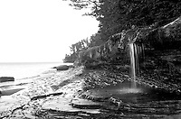 A small waterfall that flows into Lake Superior along the Pictured Rocks National Lakeshore. Munising, MI