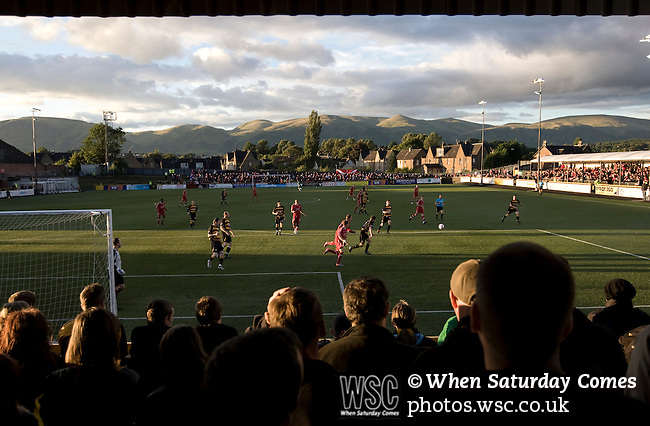 Alloa Athletic football supporters watching their team defending at Recreation Park during the Co-operative Insurance Cup second round match with visitors Aberdeen, with the Ochil Hills providing the backdrop. Scottish League second division Alloa lost the match by three goals to nil against their Premier League rivals in a match watched by 1649 spectators.